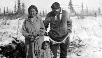 "Inuit couple with their child. Claude refers to the man as ""Husky Charlie."""