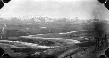 July 1923, Panorama of the Pelly River Valley with the Pelly Mountains visible in the background.