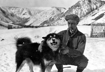 """There′s a land where the mountains are nameless, And the rivers all run God knows where. Service, my Husky Dog."" Claude's caption quotes Robert Service, the namesake of his dog."