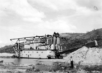 Claude standing near YCGC dredge #4 at the Arlington, summer 1939.