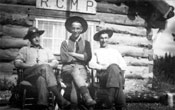 Claude (centre) poses with Robert McCleary (left) and F.W. Miller (right) at RCMP post in Teslin.