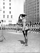 R.C.M.P. Claude Tidd salutes during the ceremony at which he was decorated with the R.C.M.P. Long Service Medal. Vancouver, 1935.