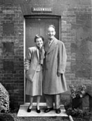 """There is nothing in the world so contagious as laughter and good humour!"" Claude and Mary at their cottage, ""Allswell"", in England."